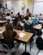 Students at Gulf Breeze High School receive instruction in science on Sept. 18.