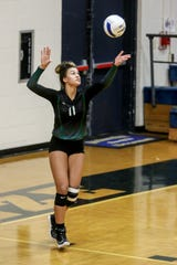 Catholic's Amiah Butler (11) serves the ball against the Dolphins during the game at Gulf Breeze High School on Tuesday, Sept. 17, 2019.