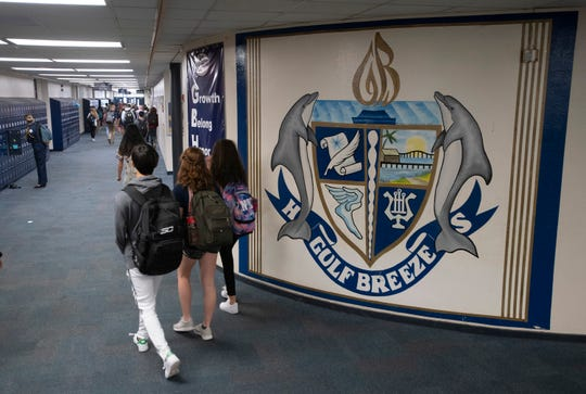 Gulf Breeze High School students fill the hallways at the school on Wednesday.