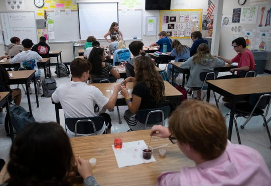 Gulf Breeze High School students are pictured in class last month.