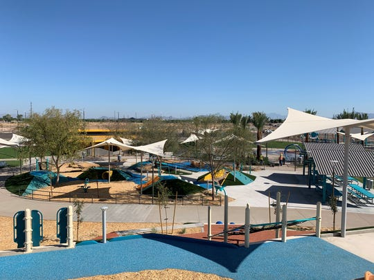An overview of the tot play area, splash pad and ramadas from the top of the playground at the new Gilbert Regional Park.