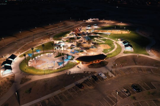 Phase one of the Gilbert Regional Park lit up at night. The playground and splash pad will be open starting Sept. 21.