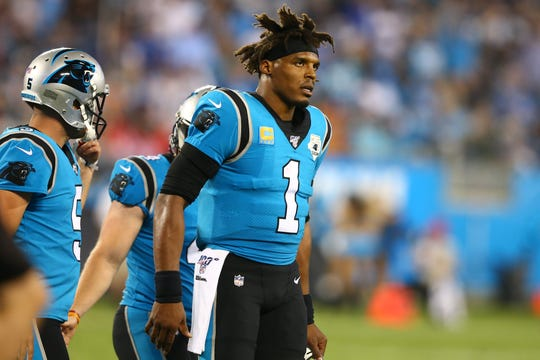 Panthers quarterback Cam Newton (1) walks off the field during the second quarter of a game Sept. 12 against the Buccaneers at Bank of America Stadium.