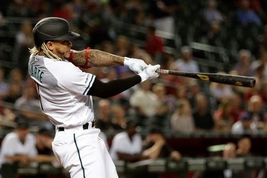 Arizona Diamondbacks' Ketel Marte follows through on a double against the Miami Marlins during the first inning of a baseball game Tuesday, Sept. 17, 2019, in Phoenix.