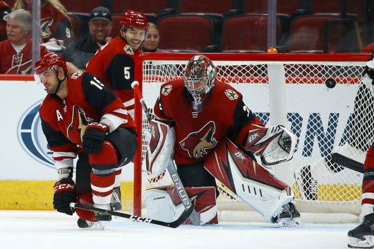 Arizona Coyotes goaltender Antti Raanta, right, gives up a goal to Los Angeles Kings' Michael Amadio as the puck gets past Coyotes' Brad Richardson (15) and Robbie Russo (5) during the second period of a preseason NHL hockey game Tuesday, Sept. 17, 2019, in Glendale, Ariz.