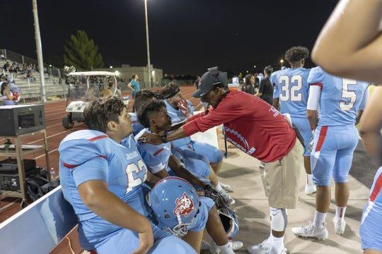 Head Coach Mark Carter talks to Brian Fair Jr. during the game against Paradise Valley High School on Sept. 6, 2019.