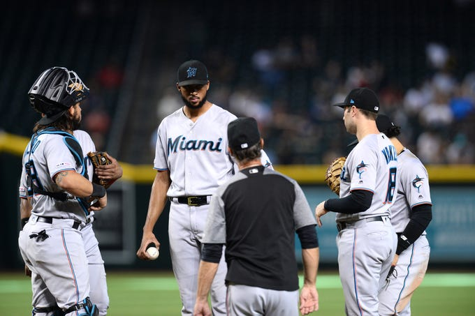 Marlins pitcher Sandy Alcantara (22) looks on as Manager Don Mattingly pulls him from a game against the Diamondbacks during the sixth inning of a game Sept. 18 at Chase Field.