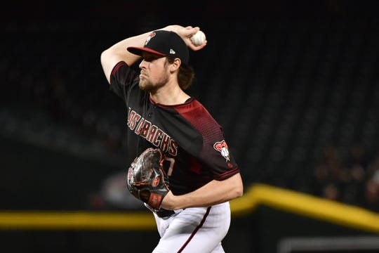Diamondbacks reliever Kevin Ginkel (37) secured his first big-league save against the Marlins on Monday.