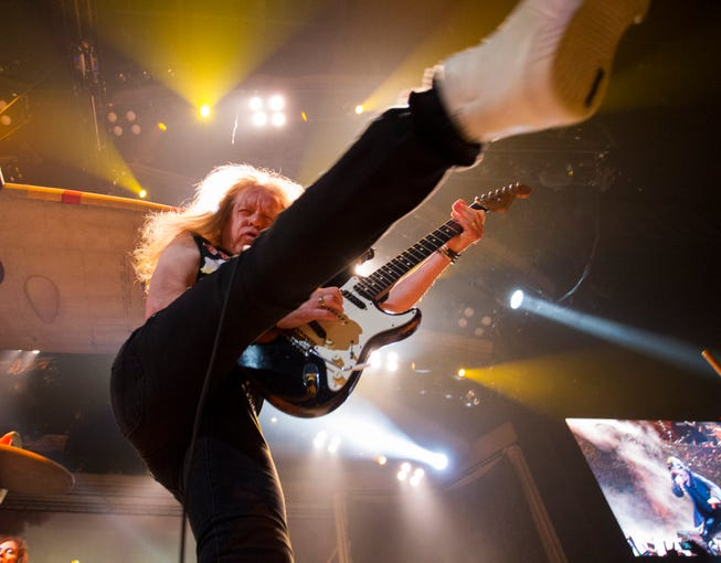 Iron Maiden's Janick Gers entertains during their show at Talking Stick Resort Arena in Phoenix on Sept. 17, 2019.