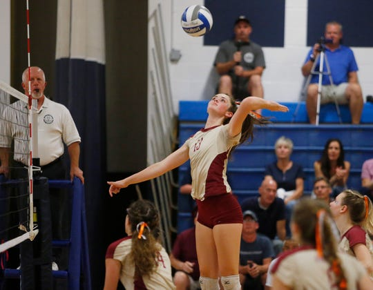 Arlington's Irene Kitson spikes the ball during Tuesday's match versus John Jay on September 17, 2019.