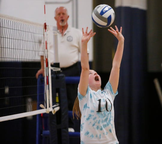 John Jay's MJ Cadden lobs the ball up during a volleyball match on Tuesday against Arlington.
