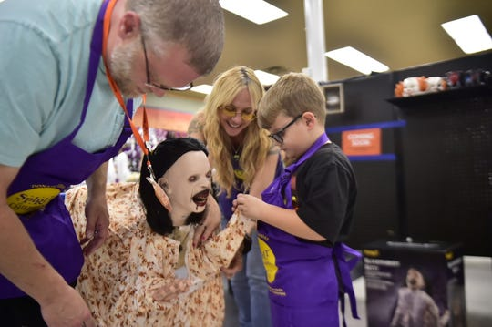 """Declan McMullen, 6, loves everything that has to do with Halloween. His favorite store, Spirit Halloween, invited him in as an honorary employee to build some of the spookiest decorations - animatronics. He decided to build """"Bloodthirsty Betty,"""" with the help of Matt Thomas, district sales manager and Jennifer Horn, store manager."""