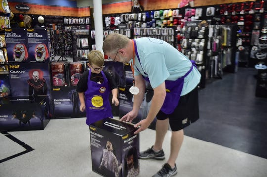 "Declan McMullen, 6, loves everything that has to do with Halloween. His favorite store, Spirit Halloween, invited him in as an honorary employee to build some of the spookiest decorations - animatronics. He decided to build ""Bloodthirsty Betty,"" with the help of Matt Thomas, district sales manager."