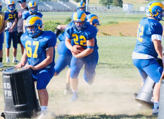 Kennard-Dale senior fullback Wyatt McCleary, center, runs the ball during a practice drill. McCleary is second in the York-Adams League with 722 rushing yards through four games.
