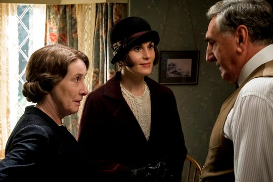"From left, Phyllis Logan as Mrs. Hughes, Michelle Dockery as Lady Mary Talbot and Jim Carter as Mr. Carson in ""Downton Abbey."" The film is playing at Regal West Manchester, Frank Theatres Queensgate Stadium 13 and R/C Hanover Movies."