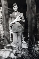 Clair Good poses with his new trumpet while he served in the Army in Colorado Springs in 1943.