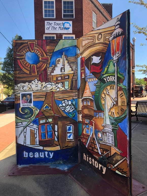 Ophelia Chambliss painted this installation at East Princess and South Queen Street and recently added a painting of Edwin and Delma Rivera.