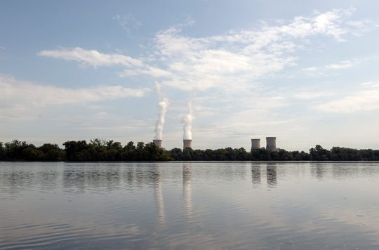 Looking from Goldsboro, Pa., on the York County side of the Susquehanna River, condensation streams from the cooling towers of Three Mile Island Island's Unit 1 during the last week of operation. The cooling towers of Unit 2 have been without steam since March 1979 after the most significant accident in U.S. commercial nuclear power plant history.