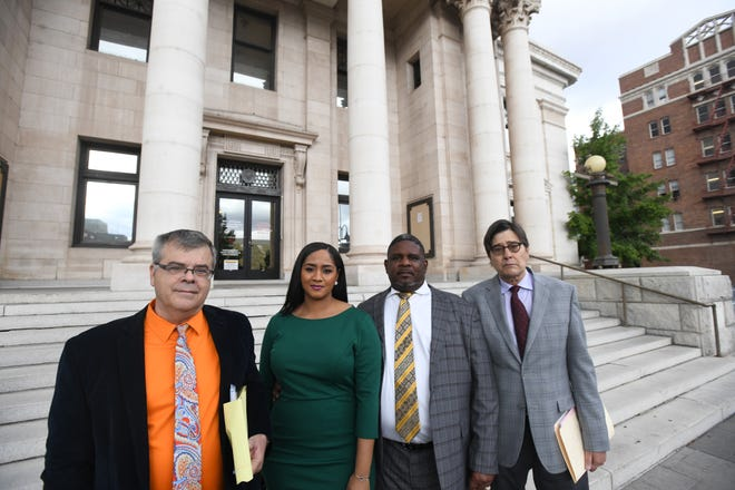 Leilani Tau-Schneider and Michael Schneider (center) stand in front of Second Judicial District Court in downtown Reno on Wedensday, Sept. 18, 2019 after pleading not guilty to several animal mistreatment charges. they are flanked by their attorneys Richard Cornell (left) and Carter King (right).