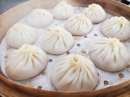 Xiao long bao (steamed dumplings filled with pork broth)