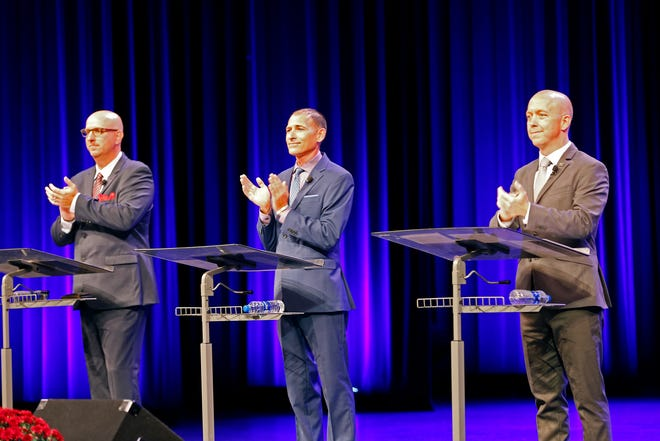 Richmond mayoral candidates (from left) Jamie Lopeman, Thomas Owens and Dave Snow take the stage at the beginning of HYPE Richmond's mayoral debate on Tuesday, Sept. 17, 2019.