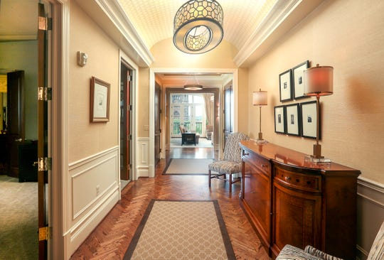 The long main entrance to a penthouse unit welcomes visitors.