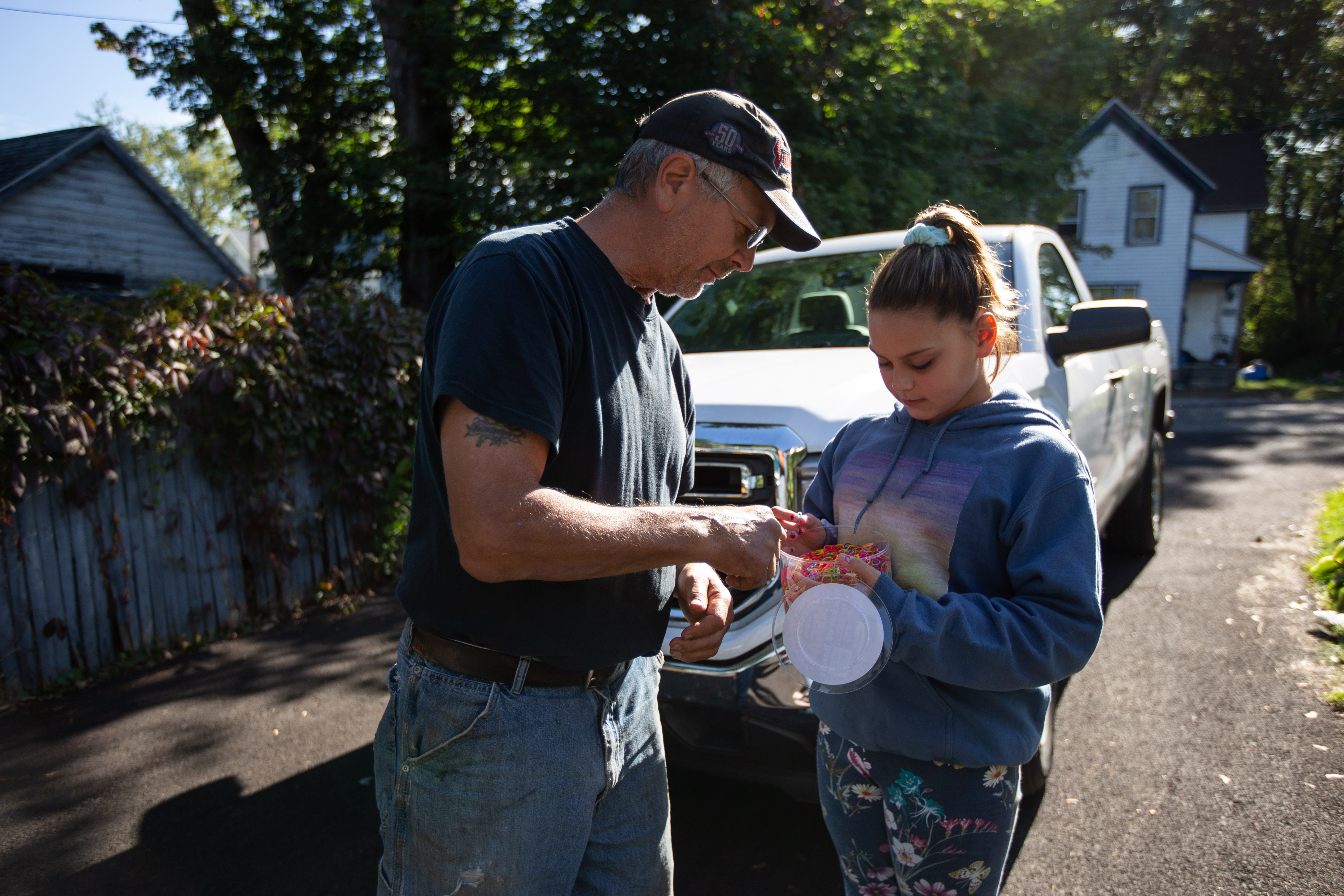 Aubrey Steenburg, 11, asks her grandfather Dutch Andrews to pick out colors he'd like for a rubber band bracelet. Aubrey was home sick from school on Monday, Sept. 16, 2018 and spent the day with her grandfather. Rich Steenburg, Aubrey's father, was one of 20 people killed in the Schoharie limousine crash on Oct. 6, 2018.