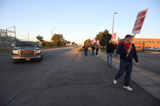 GM workers picket early Wednesday outside the GM plant on Lexington Ave.  GM workers across the country including in Rochester are on strike after their contract expired.