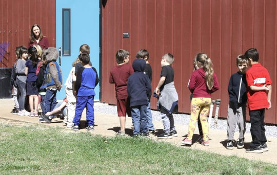 Students at Black Butte Elementary School wait in line to have lunch in the school's cafeteria Tuesday, Sept. 17, 2019.