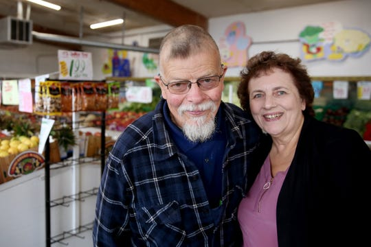 Owners Ed and Melanie Norman at Norman's Farmers Market in Salem on Sep. 18, 2019. The store will close in October after 40 years of selling produce in northeast Salem.