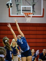 Chincoteague's Alanna Hall reaches for a set shot against Arcadia during their game in Oak Hall.
