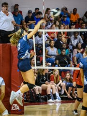 Emma Jackson of Chincoteague powers the ball across the net to Arcadia during their game on Sept. 17.