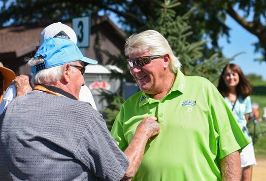John Daly meets Denny Sanford at hole three while playing a pro-am round of golf ahead of the Sanford International tournament on Wednesday, September 18, at the Minnehaha Country Club in Sioux Falls.