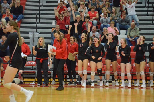 Brandon Valley head coach Marette Grage celebrates a point with her team against Harrisburg on Tuesday, Sept. 17.
