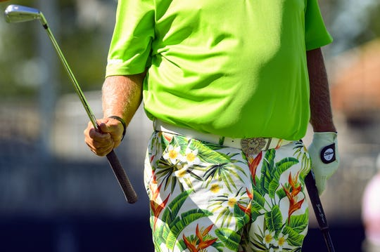 John Daly is decked out in a lime green shirt, jungle print shorts and a lion's head belt buckle during a pro-am round of golf ahead of the Sanford International tournament on Wednesday, September 18, at the Minnehaha Country Club in Sioux Falls.