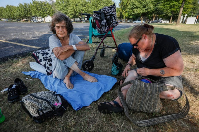 Janetta Stevens, left, sits on her bedding with Patty Belt on Tuesday, Sept. 18, 2019, in Springfield, Mo. Stevens sleeps outside now because the shelter only allows women to stay there for three months, and her time was up.