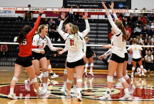 SCSU celebrates during their game against Michigan Tech Friday, Sept. 13, 2019, at Halenbeck Hall.