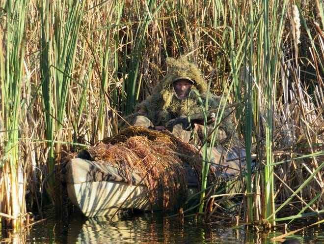 Michigan resident Jeff Carlson makes use of a hunting kayak and excellent concealment as part of his duck hunting scheme.