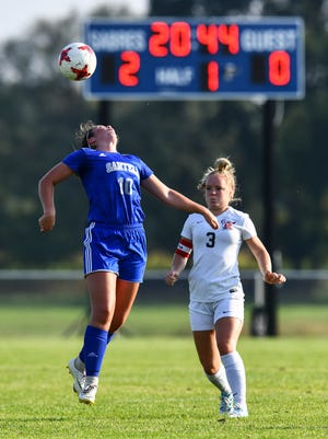 Sartell's Christa Meyer leaps for the ball during the Tuesday, Sept. 17, 2019, game at Sartell High School. Meyer is one of six Sartell players named to the 2019 SC Times All-Metro Girls Soccer Team.