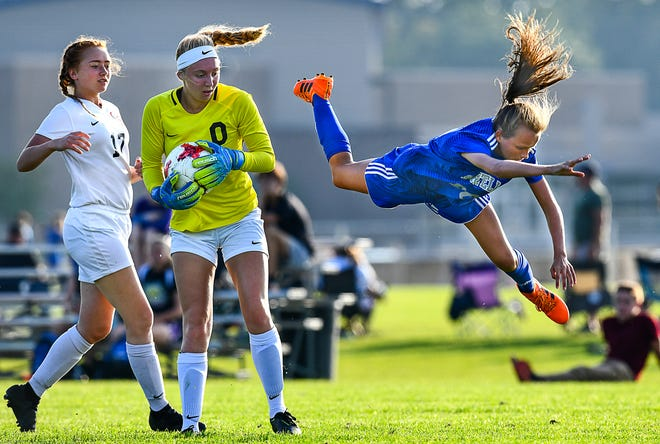 Sartell's Chloe Turner flies past a play near the ROCORI goal during the Tuesday, Sept. 17, 2019, game at Sartell High School. Sartell scored five goals in the first half on the way to a 6-1 conference win. For more photos from the match, visit www.sctimes.com/sports.