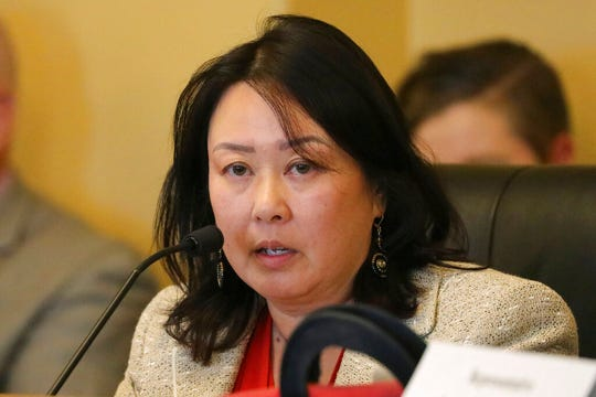 In this Monday, Sept. 16, 2019, photo, Rep. Karen Kwan speaks during a committee hearing at the Utah State Capitol, in Salt Lake City. Utah is the latest of nearly two dozen states across the country that are spending millions of their own money to make sure residents fill out next year's census form amid fears that undercounting could mean losing federal funding or crucial seats in Congress. (AP Photo/Rick Bowmer)