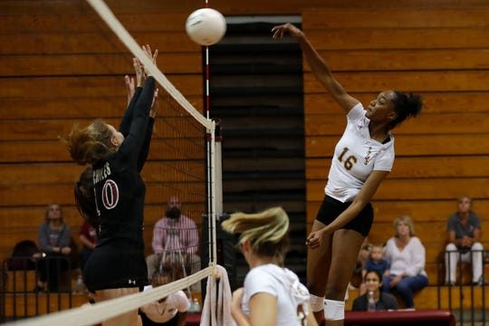 Florida High Seminoles middle blocker Khori Louis (16) hits from the right side. The Chiles Timberwolves defeated the Florida High Seminoles after a hard fought five sets Tuesday, Sept. 17, 2019.