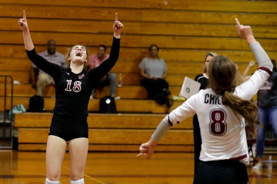 Chiles Timberwolves setter Taylor Brantley (18) celebrates a point with Chiles Timberwolves libero Addison Hultquist (8). The Chiles Timberwolves defeated the Florida High Seminoles after a hard fought five sets Tuesday, Sept. 17, 2019.