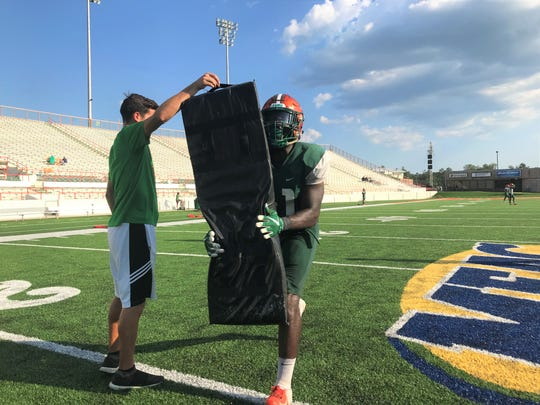 FAMU linebacker Doyle Grimes works on a tackling drill with graduate assistant Colin Diaz on Tuesday, Sept. 17, 2019. The Rattlers face the Southern Jaguars on Sept. 21.