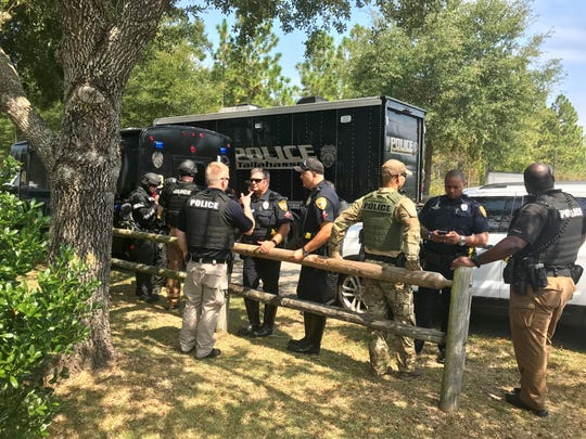 Members of the Tallahassee Police Department's Tactical Apprehension and Control Team gather at Fort Braden Community Park in response to a lethal standoff with deputies on Sept. 18, 2019.