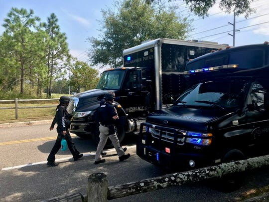 Tallahassee Police Department Tactical Apprehension and Control Team vehicles arrives at the command center in Fort Braden.