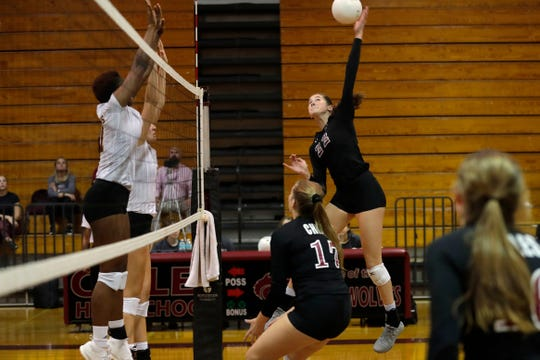 Chiles Timberwolves right side hitter Marina Oognibene (22) swings through the block. The Chiles Timberwolves defeated the Florida High Seminoles after a hard fought five sets Tuesday, Sept. 17, 2019.