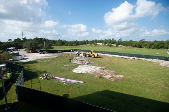 "Currently in phase one of construction with site preparation and foundation work underway, a new arts and athletics building is due to emerge on The Pine School's sprawling campus, seen Wednesday, Sept. 18, 2019, in Hobe Sound. The school is still fundraising for the $6.8 million, 24,000 square foot building and Head of School Binney Caffrey says the multi-purpose space will provide many benefits, potentially including partnerships with area organization to host speakers or art galleries. ""I think it will be a real asset to the school and to the community,"" Caffrey said."