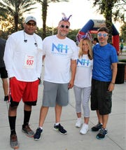 New Horizons Race for Recovery staff members Oscar Pitman, left, Kory Snyder, Jen Timothy and John Poli at the 2018 race.