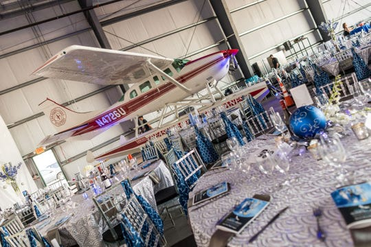 2019 Wine Women & Shoes VIP ticket holders receive prime reserved table seating inside the Sun Jet Aviation hangar at Vero Beach Regional Airport.
